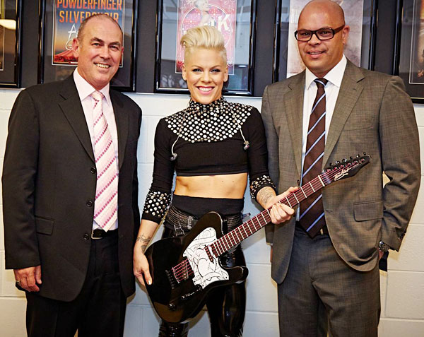 P!NK receiving a custom-made Tomkins Guitar from Tim Worton (Group Director - Arenas, AEG Ogden) and Guy Ngata (General Manager, Allphones Arena) to commemorate her 2013 Sydney concerts at the Allphones Arena.