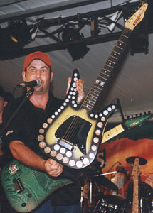 Col Finley with his own Tomkins guitar, inlaid with coins