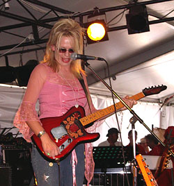 Beccy Cole on guitar